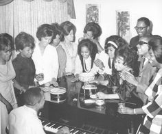 The Motown family. The Supremes, The Marvelettes, Brenda Holloway Kim Weston, Bobby Rogers of The Miracles, Stevie Wonder and Berry Gordy on the Piano, 1964