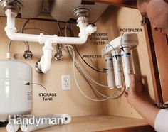 Mount the storage tank and sanitize - Install a Reverse Osmosis Water Filter: http://www.familyhandyman.com/plumbing/install-a-reverse-osmosis-water-filter/view-all