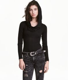 Black. Long-sleeved bodysuit in soft viscose jersey with a draped hood, draped neckline at front, and snap fasteners at gusset.