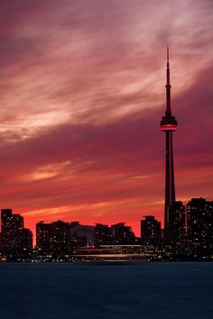 CN Tower, Skydome (Rogers Center), island ferry at sunset, Toronto, Canada