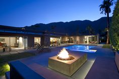 I like the off center fire pit and the concrete benches.