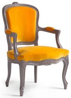 I love this little Louis chair dressed up in orange, perfect!