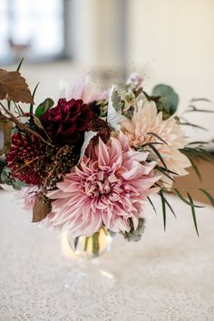 Small autumn centerpieces featuring dahlias and antique mums. Designed by Love 'n Fresh Flowers. Photo by Emily Wren Photography.