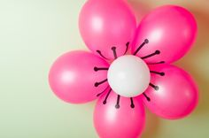 DIY Cherry Blossom Balloons.  Tutorial from Christine of Pure Joy Events.  A bunch of these would make an AWESOME party backdrop!