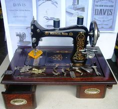 Davis Vertical Feed Antique sewing machine,treadle type,oak display board,1900