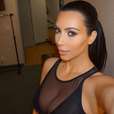 Selfie queen: 'Back to my roots,' Kim captioned this Instagram photo on Thursday