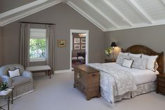 Amazing Home Interior Design with Driftwood Furniture: White Trim And Gray Walls In Cool Farmhouse Bedroom Design With Curtain Panels And Dark Stained Wood Also Driftwood Furniture With Upholstered Bench And Vaulted Ceiling Plus Wooden Beams With Wooden Ceiling ~ idobrich.com Furniture Inspiration