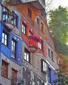 Backpacking Europe in 21 days.  Fourth stop - Vienna, Austria  Hundertwasserhaus. Life must be colorful living in these apartments. A wonder to see when in Vienna.  by: @iamchristinetaj ... ... #wigglefoot #backpackingeurope #beautifuldestinations #lonelyplanet #canon #interraileu #europeroamers #vienna #vienn #travel #austria #discoveraustria #hundertwasserhaus