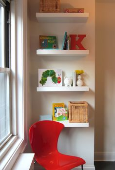Floating Shelves and an Italian chair make a colorful splash in a childs playroom. Kapito Muller Interiors