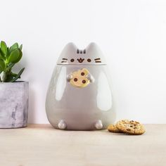 Keep your rampant snack cravings in check and stow your biscuits inside the welcoming belly of this Pusheen cookie jar! Made from glazed ceramic, Pusheen will gladly keep your cookies from going stale and chewy until you're feeling a bit peckish.