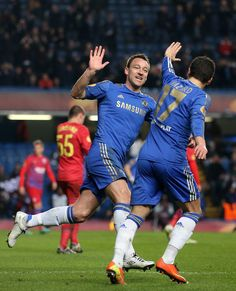 Eden Hazard Photos - John Terry of Chelsea celebrates scoring their second goal with Eden Hazard of Chelsea during the UEFA Europa League Round of 16 second leg match between Chelsea and FC Steaua Bucuresti at Stamford Bridge on March 14, 2013 in London, England. - Chelsea v FC Steaua Bucuresti