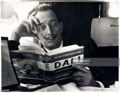 Salvador Dali reading his biography, 6 May, 1959. A photograph of the Spanish artist Salvador Dali (1904-1989), taken by Terry Fincher for the Daily Herald newspaper. Dali is reading Fleur Cowles' book 'The Case of Salvador Dali' (1959), whilst on a train from Folkestone, having travelled from France. Cowles' book was an authorised biography of Dali. With a studied expression of shock on his face, Dali enjoys the photo opportunity. One of the most famous, charismatic and notorious artists of…