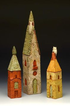 holden mccurry . architectural ceramic towers, hand built with terracotta slabs . multiple fired with layered under glazes and oxides and finished with polychrome touches