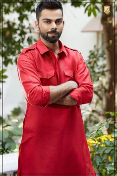 A bright red pathani to keep it suave and fashionable. This traditional outfit is the perfect combination for any evening celebration if paired with a white coloured bottom. Pathani kurta, pathani, pathani kurta pajama, pathani suit for mens, pathani suit for men, pathani suit for wedding, pathani for mens, pathani kurta for men, pathani pattern, pathani kurta design, pathani kurta for men, pathani design, pathani kurta online, pathani kurta designs, pathani dress for mens