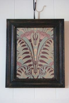 """I framed a sample of Bradbury & Bradbury's """"Lily Dresser"""" wallpaper, the same that was used in the foyer of the Haunted Mansion."""