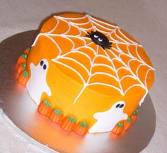 Halloween Cake - This cake was literally thrown together last minute.  Could really decide what I wanted to do and just started decorating.  This is what I ended up with.  Pumpkin spice cake (yum, I'm so glad fall is here) with buttercream.  Fondant spider and ghosts with candy pumpkins. | Don't Miss the Whole Halloween Cake Gallery!!!