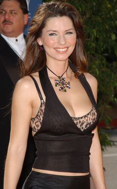 Busting a Move from Shania Twain's Sexiest Looks  There's a lot of late-1990s look still going on in Vegas at the 38th Academy of Country Music Awards in 2003. But what better to draw attention to that impressive cleavage than a massive choker?!