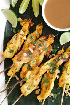 These flavorful chicken skewers are marinated in coconut milk and spices, then grilled and served with a delicious spicy peanut sauce for dipping.