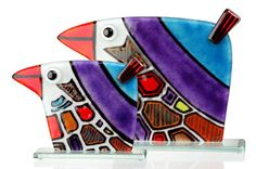 These parrots won't talk back to you! They are perfectly behaved in stunning shades fired into fused glass. Red, purple, yellow, oranges and brown vie for your attention as you stand and admire the funky design. Buy a glass table specifically to showcase your parrots!  They are hand made with love and fired in a kiln for long lasting colour. We offer two sizes, large at 20cm and small at 13cm, simply choose from the drop down menu below.