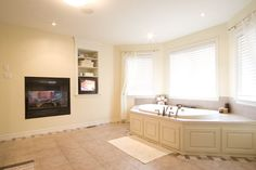 See thru fireplace and a tv to watch while relaxing in the jacuzzi!