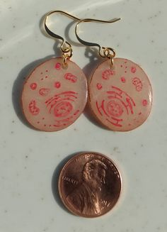 Cell Dangles! These hand-painted earrings show the details of the cell--you can see the nucleus, ER and mitochondria. Perfect for the classy, science-buff. Made with polymer clay and acrylic paint. Sealed with a resin for durability.
