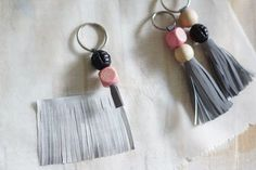 Could use this idea but using my tassel die for scalloped edge tassels with meta tassel tops under the beads for added style. Tassel Keychain, Diy Keychain, Leather Keychain, Leather Tassel, Leather Jewelry, Leather Craft, Denim Earrings, Diy Tassel, Leather Projects