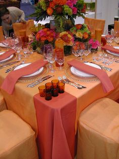 Tangerine & salmon pink table decorations.