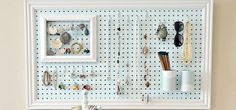 Eliminate tangles, dents, and messy piles when each necklace and earring has an individual hook. By framing the pegboard and painting it a soft, inviting color, it doubles as wall art and doesn't come off as utilitarian-style storage. See more at The 36th Avenue »  - WomansDay.com