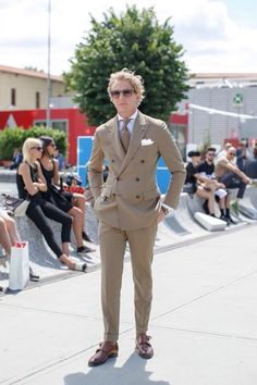 Summer weight double breasted peaked lapel suit. Double Monks note upper buckle unfastened.