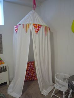made this today the easiest play tent I have seen so far I used a full size sheet instead of 2 twin ones easy and cute