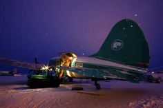 Ice Pilots: Cargo is loaded onto the WWII-era Curtiss C-46 Commando in the blistering cold at dawn. Photo credit: John Driftmier
