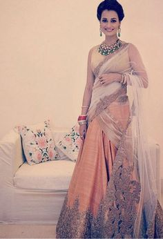 Dia Mirza was the epitome of elegance and beauty as she donned a stunning peach-gold Shantanu and Nikhil lehenga.