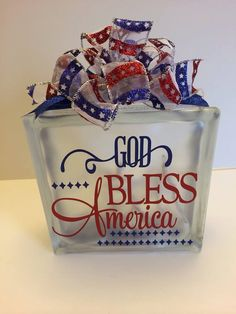 This glass block is x Vinyl saying on front- God Bless America. There are white mini craft lights on the inside , and finished off Painted Glass Blocks, Decorative Glass Blocks, Lighted Glass Blocks, Patriotic Crafts, Patriotic Decorations, July Crafts, Glass Cube, Glass Boxes, Glass Art