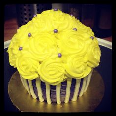 Giant cupcake cake ~ Yellow rosette cupcake cake with purple & white striped buttercream bottom.  Cupcake cake by: Bella Baby Cakes