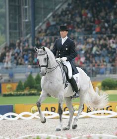 """Guenter Seidel and Aragon performing Piaffe.   Aragon was known as the """"Piaffe King"""" often receiving 9's and 10s."""