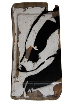 Badger face stencil painting on reclaimed wood