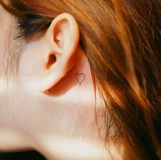 Behind-the-ear heart tattoo by Nando