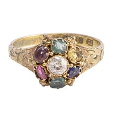 View this item and discover similar for sale at - This splendid mid-Victorian acrostic ring is set with stones that spell out the romantic sentiment 'dearest'. With a central Diamond, the others are: Emerald, Emerald Meaning, La Danse Macabre, Amethyst, Sapphire, Eternity Ring, Vintage Beauty, Precious Metals, Topaz, Diamond Cuts