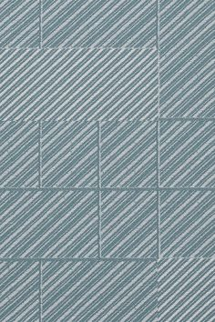 The jacquard-woven Utopia by Doshi Levien features diagonal lines in varying dimensions that are divided into larger squares.