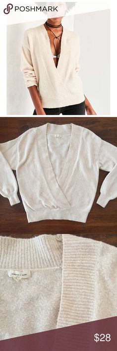 """Urban Outfitters cozy surplice sweater in cream Super soft oversized sweater in a cream / very pale blush pink. Gently worn. 20"""" from underarm to underarm and 24"""" long. """"Super cozy plunge-front surplice sweater from our modern staple label, Silence + Noise. In a plush sweater-knit with a slightly slouchy fit trimmed with fitted stretch hems and a cross-front deep V-neck for a bare layered look over bodysuits, bra tops + camis. - Cotton, nylon, acrylic, Spandex - Hand wash Urban Outfitters…"""