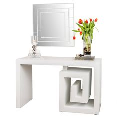 White-finished wood console table with a Greek key-inspired design.   Product: Console tableConstruction Material: