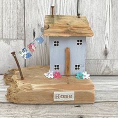 Original driftwood art by ontheTides This is a beautiful little wooden house handmade using driftwood and salvaged wood. The house has been painted in pale duck egg blue with white window frames and black frames. A little line of washing has been strung up between the house and the
