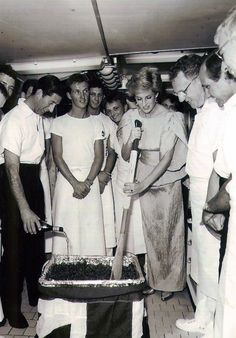 Princess Diana stirs the Christmas Pudding mixture while on board Britannia when she was in Royal service. © Crown Copyright http://www.royalyachtbritannia.co.uk/