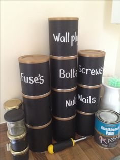 These are recycled baby milk powder tins. Could use something similar to sort out garage stuff?