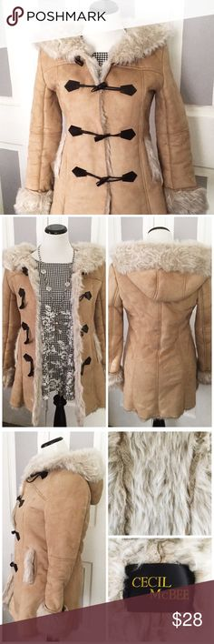 Cecil McBee Fur Lined Suede Coat Beautiful super warm Cecil McBee suede and faux fur lined coat. Features shaggy faux fur lined through out the coat, 4 toggle closures and a hood. In excellent used condition. PLEASE NOTE: Cecil McBee is a Japanese designer and the coat runs small. It fits more like a Juniors XS or a Girls size 14/16. Cecil McBee Jackets & Coats