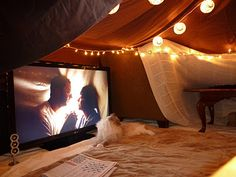 Movie night under a romantic lighted fort
