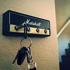 Hang your keys like a Rockstar! Shut up and give me the details! Includes 4 guitar plug keychains engraved with the Marshall M logo 1 wall mounting bracket...