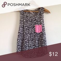 PINK Victoria Secret cheetah print tank top PINK Victoria's Secret cheetah print tank top with pink pocket. Muscle tee style tank with scoop neck PINK Victoria's Secret Tops Tank Tops