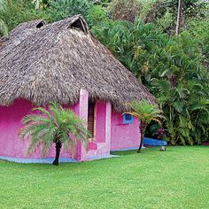 This vivid pink cottage is one of Costa Careyes' three bungalows overlooking the ocean (scan the surf for whales!), just steps from the soft Playa Rosa sand.
