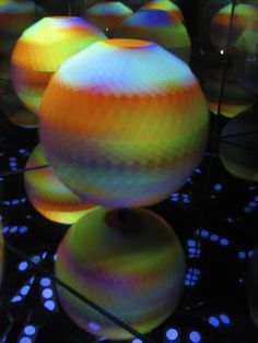 the 'artstrobe' by leif maginnis uses pulsating ultraviolet light and fluorescent-colored polyhedrons to create a mesmerizing display of whirling patterns